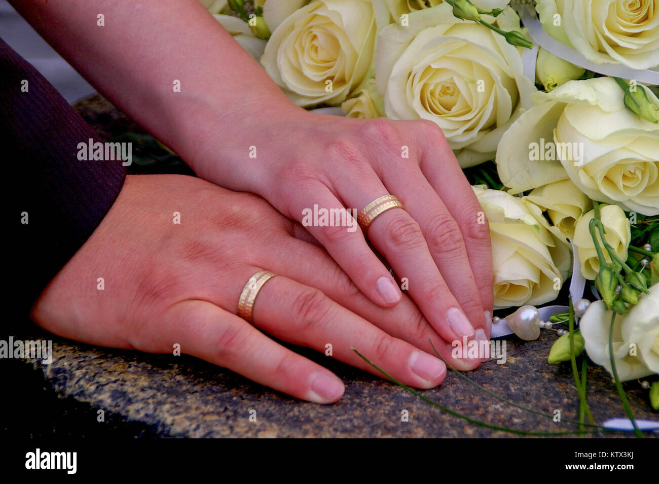Holding Wedding Rings During Wedding Stock Photos & Holding Wedding ...