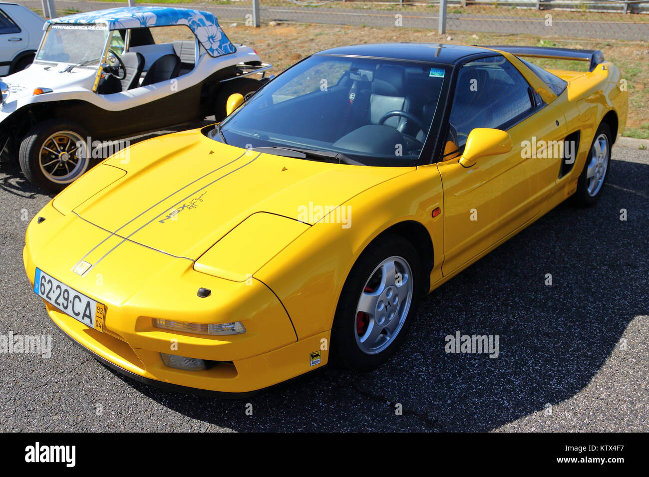 A yellow Honda NSX Sports Car at the Estoril Race Course in Portugal - Stock Image