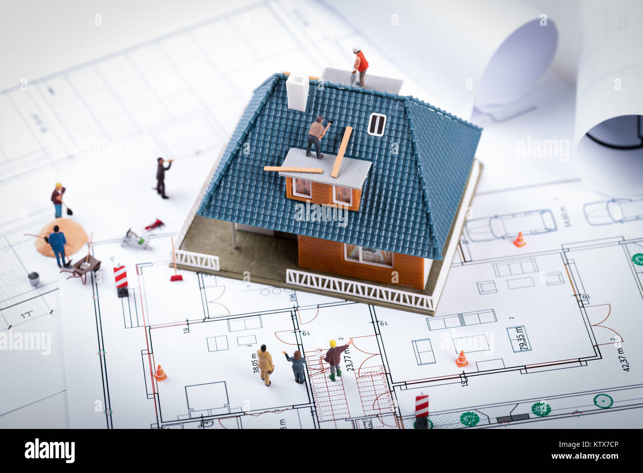 House construction project concept building scale model and workers house construction project concept building scale model and workers on blueprint malvernweather Images