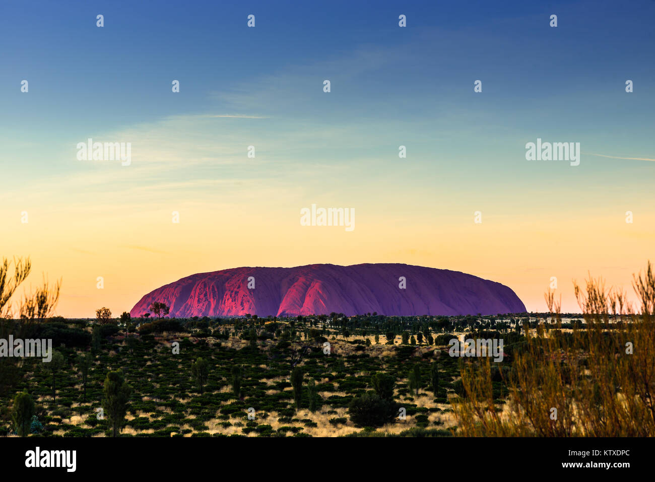 Uluru (Ayers Rock) at sunrise, Uluru-Kata Tjuta National Park, UNESCO World Heritage Site, Northern Territory, Australia, Stock Photo