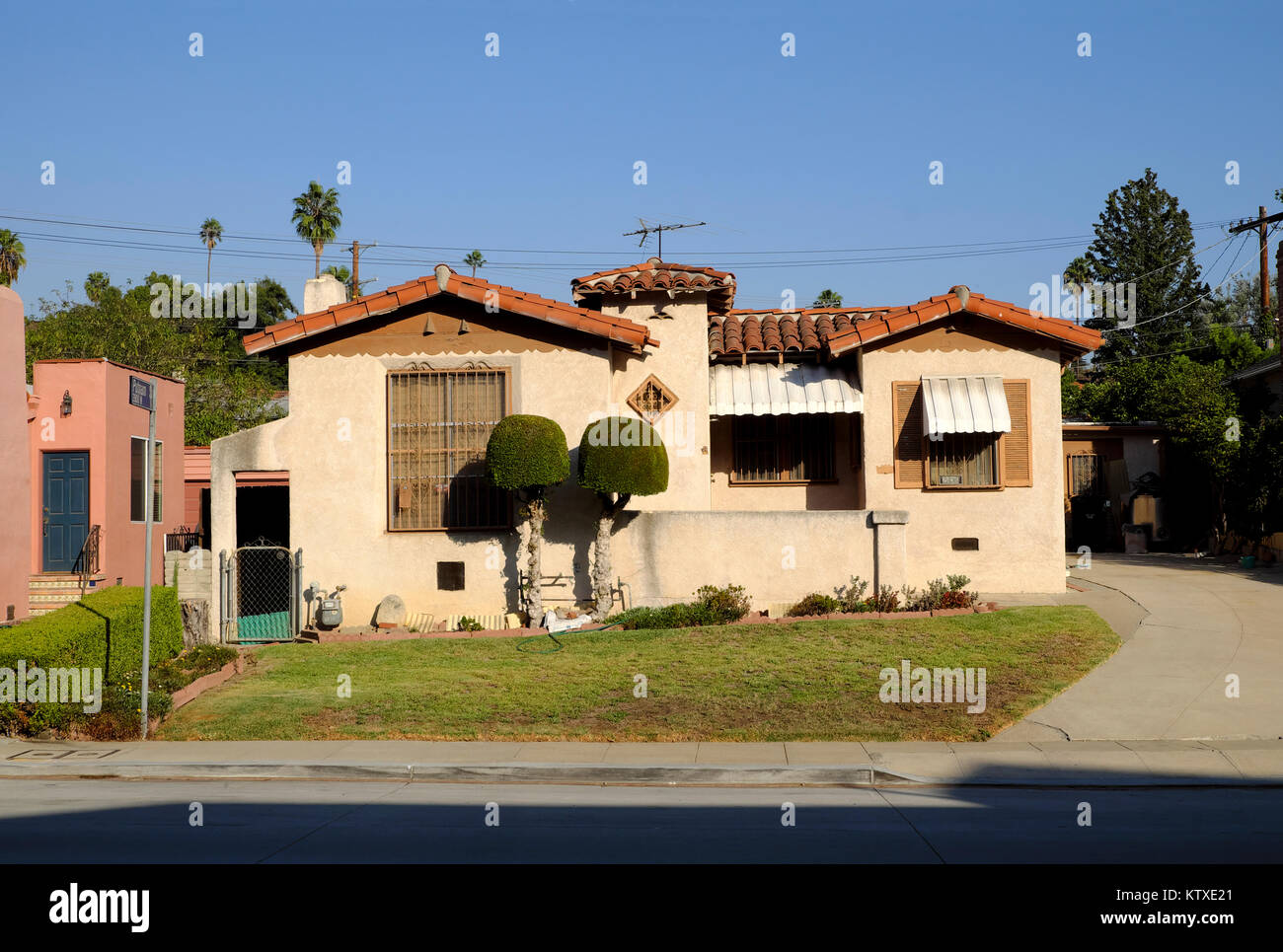 A small spanish style house with tiled roof in the for Spanish style tiny house