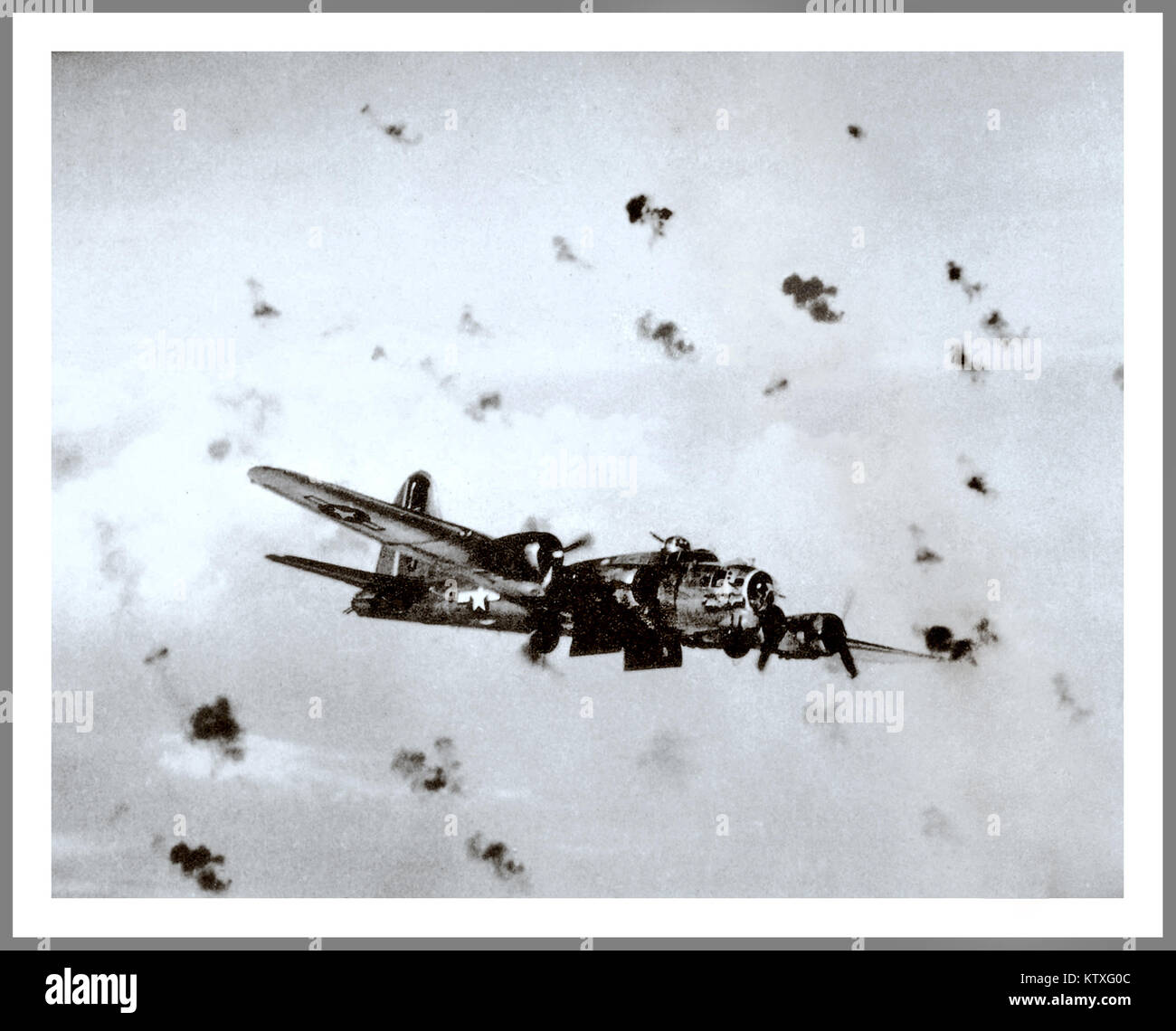 USAAF World War 2 WW2 U.S. Army Air Force Boeing B-17G Flying Fortress flying through heavy flak with bomb doors Stock Photo