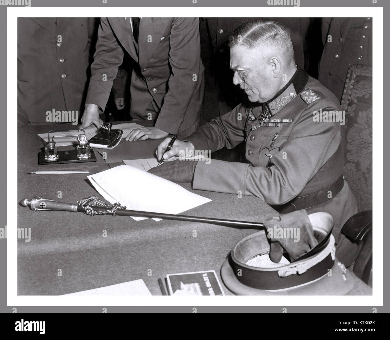 Field Marshall Wilhelm Keitel, signing the surrender document for the German Army at Russian Headquarters in Berlin, - Stock Image