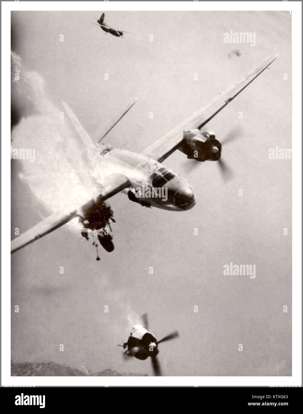 American Airforce USAAF B26 Bomber over France. Grim reality war image of a crippled American B-26 Marauder aircraft - Stock Image