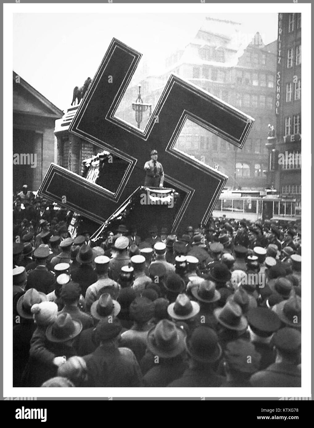 Pre-War Nazi rally using the Swastika as a gigantic mobile prop, as here in a photograph taken in Hamburg Germany - Stock Image