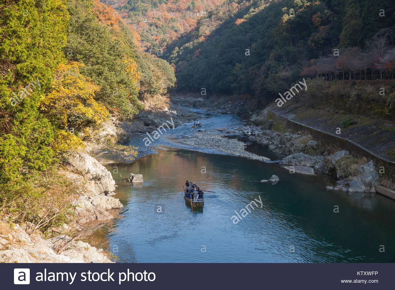Kyoto, JAPAN - NOVEMBER 28, 2017: Top view traveler on the boat in Hozu-gawa river from Torokko Hodukyo station - Stock Image