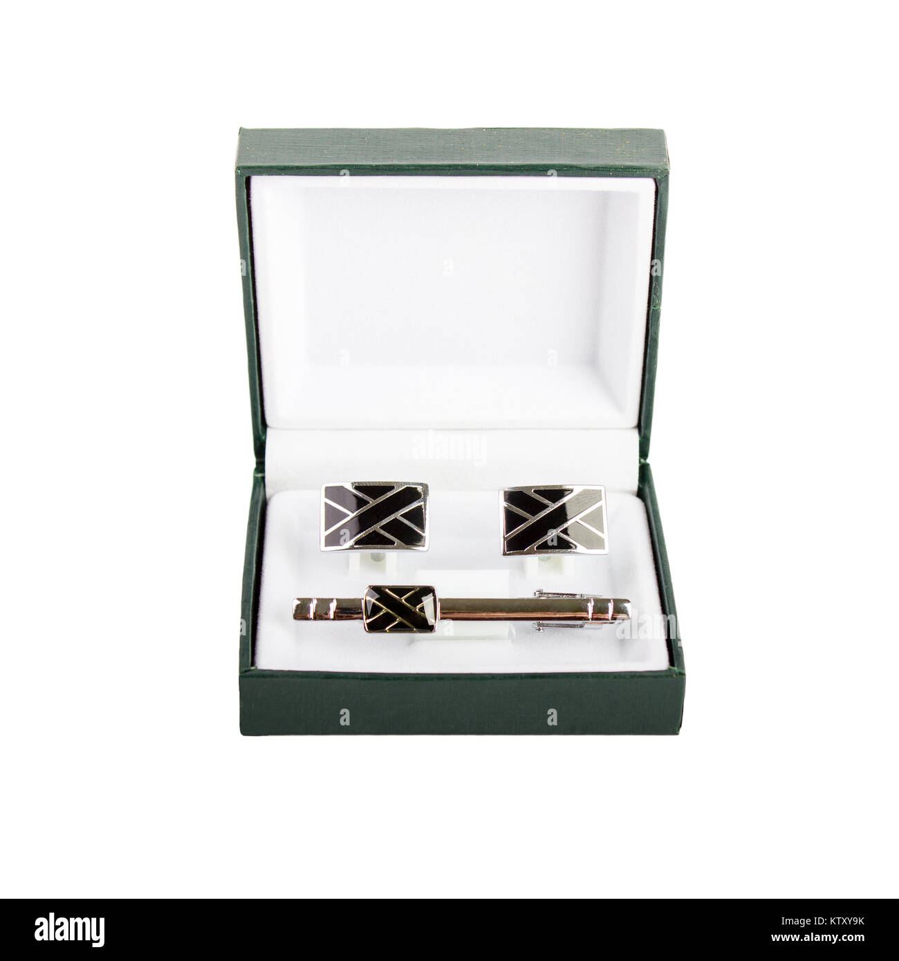 Cuff links in a box on white background. Male fashion accessories. - Stock Image