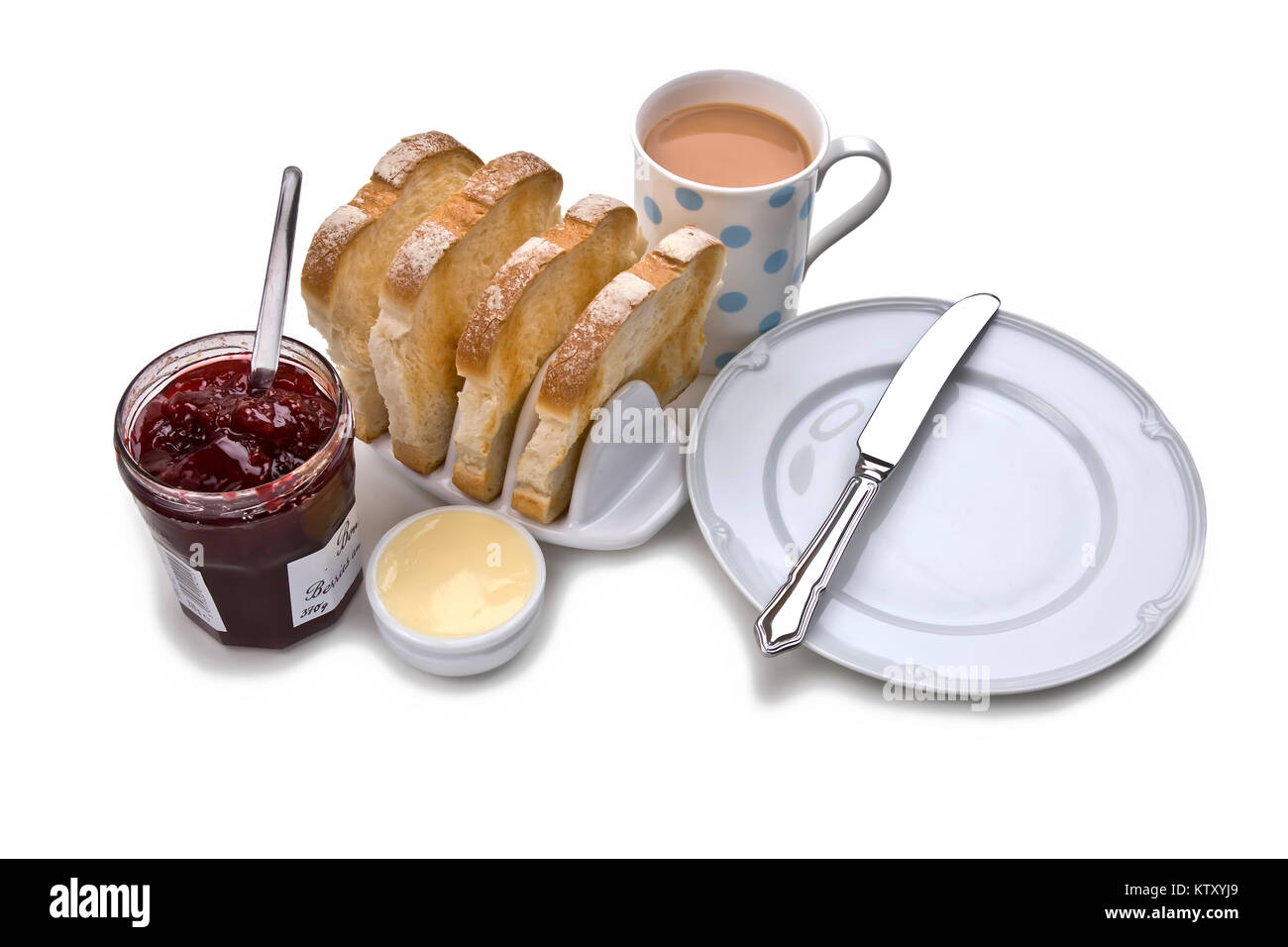 White toast breakfast with ceramic toast rack butter; red jam mug of tea serving plate and knife on white background  sc 1 st  Alamy & White toast breakfast with ceramic toast rack butter; red jam mug ...
