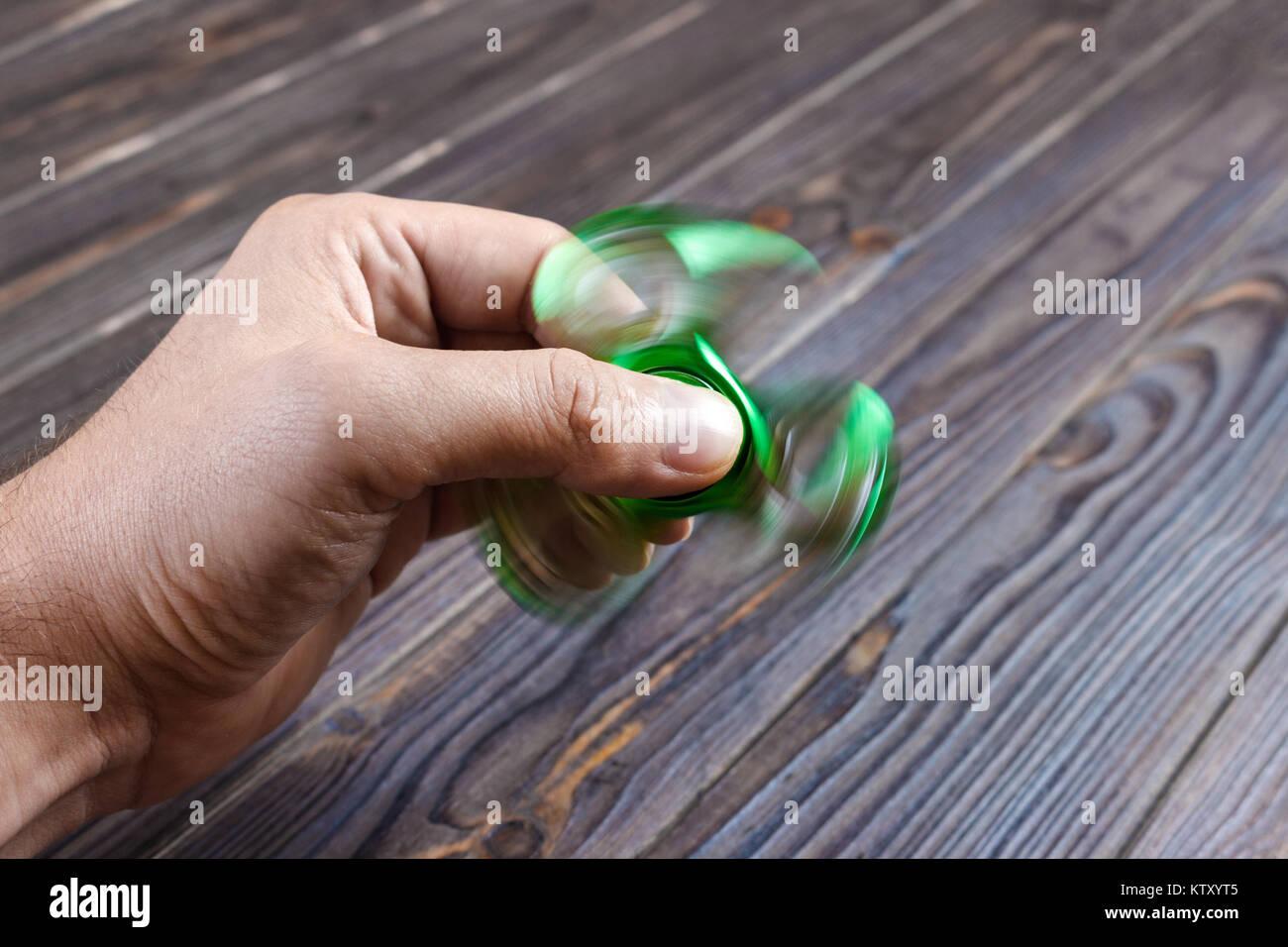 Hands holding popular fidget spinner toy. fidgeting spinner. Stock Photo