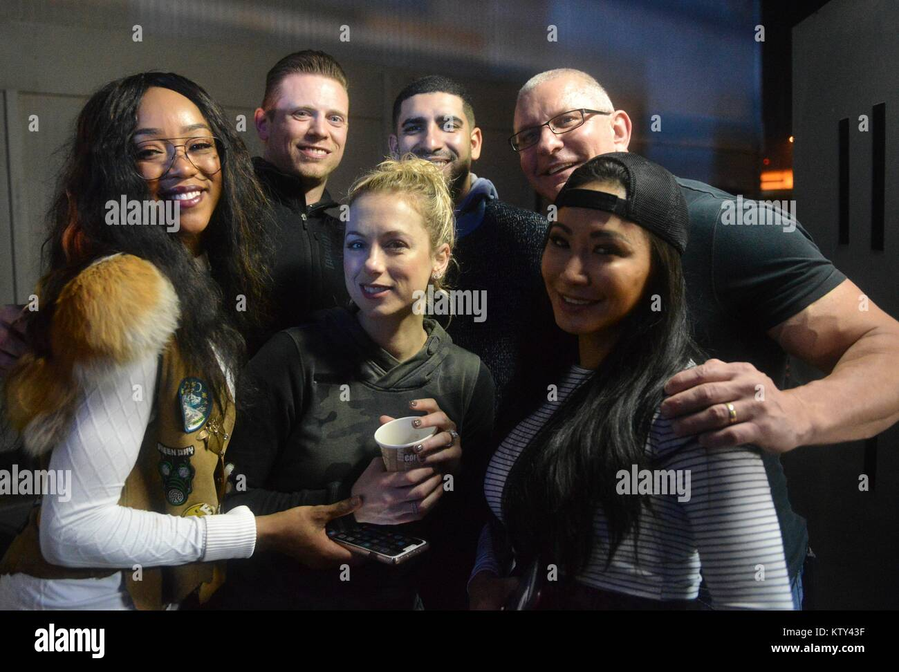 World Wrestling Entertainment (WWE) wrestlers (back, L-R) Alicia Fox, The Miz (Michael Mizanin), U.S. Army Medal - Stock Image
