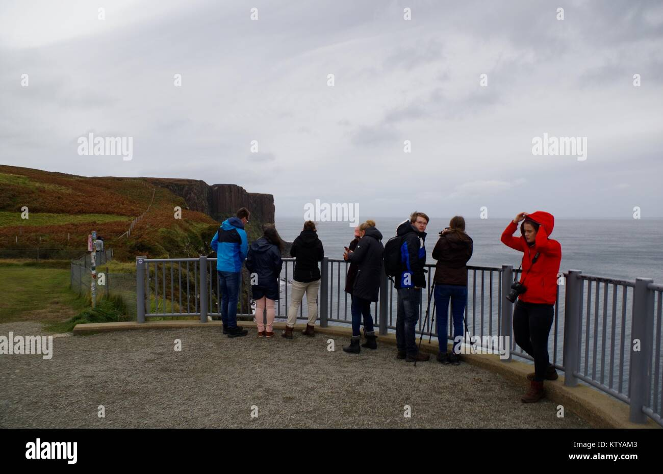 Tourists at the Viewing Platform, Kilt Rock and Mealt Falls, Isle of Skye, Scotland, UK. - Stock Image