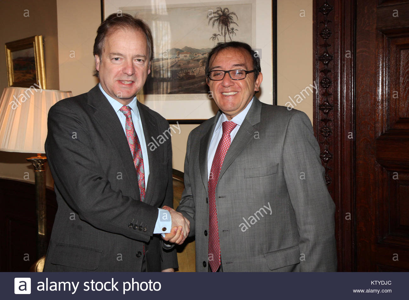 Foreign Office Minister Hugo Swire with Colombian Constitutional Court Judge, Luis Ernesto Vargas Silva in London, - Stock Image
