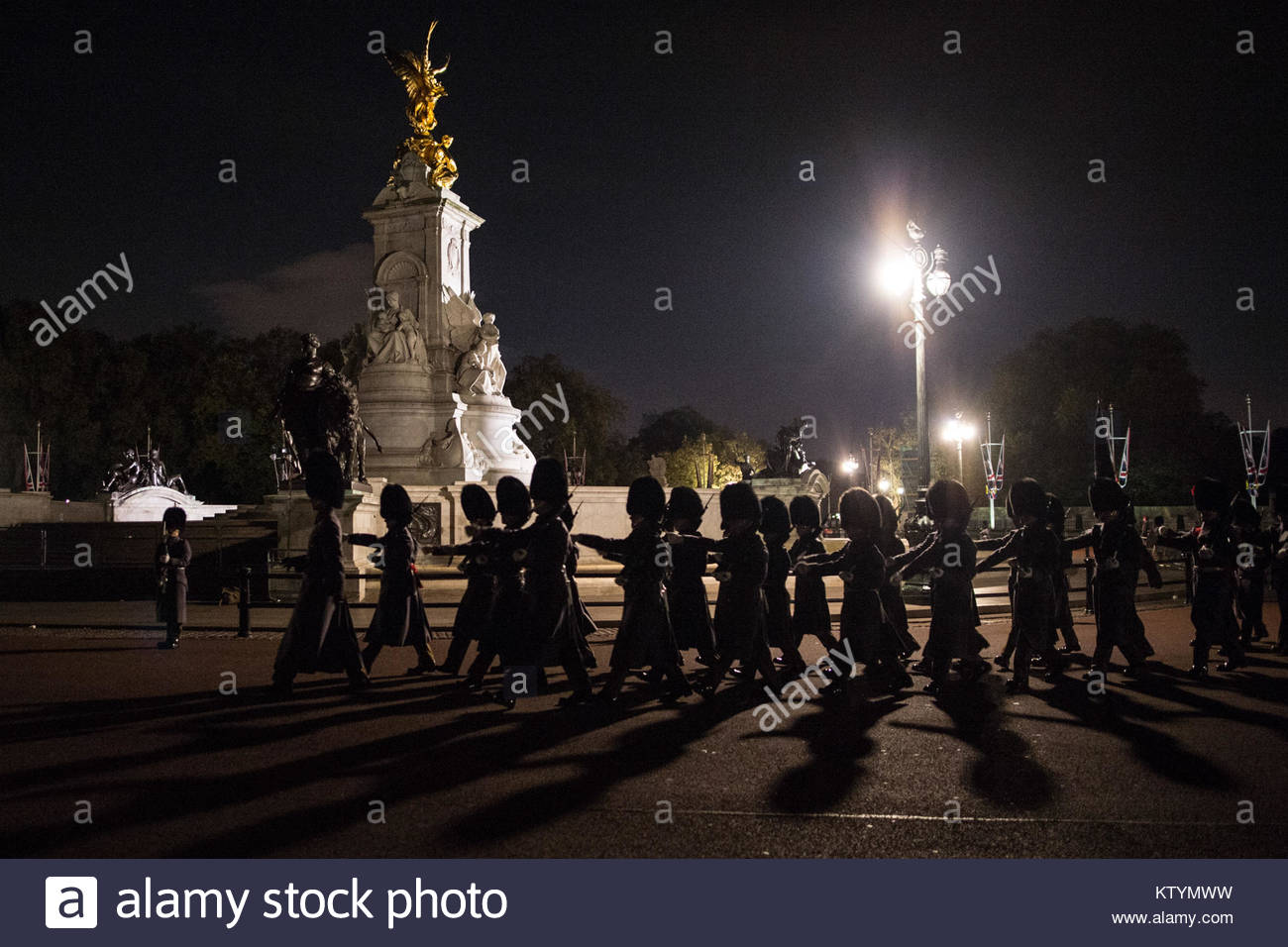 Pictured is the Victoria Memorial, as a Guard of Honour formed of the Grenadier Guard's moves toward Buckingham - Stock Image