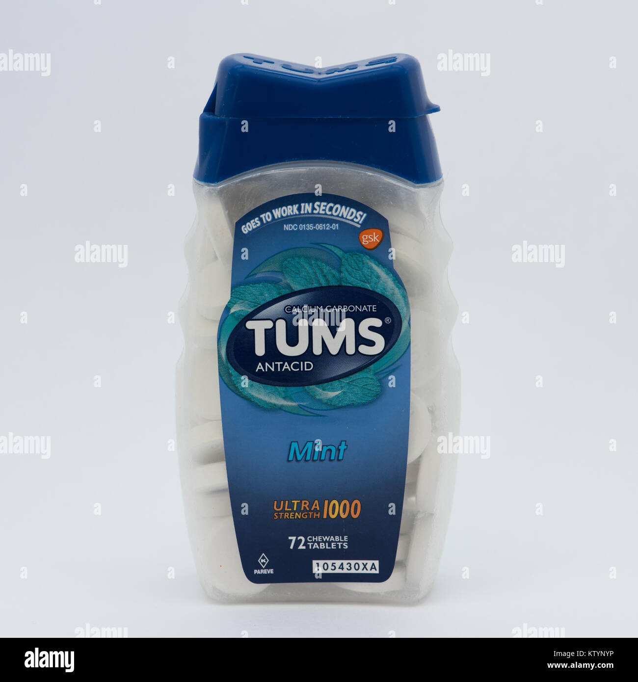 A bottle of Tums brand antacid tablets used to provide relief from acid indigestion, heartburn and acid reflux issues. - Stock Image
