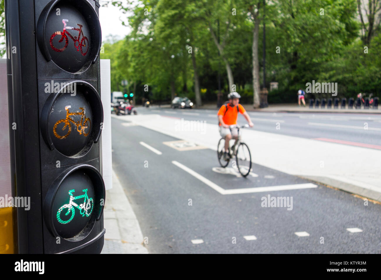 Cycle traffic lights for pedestrian crossing East-West Cycle Superhighway, Victoria Embankment cycle path. London, - Stock Image