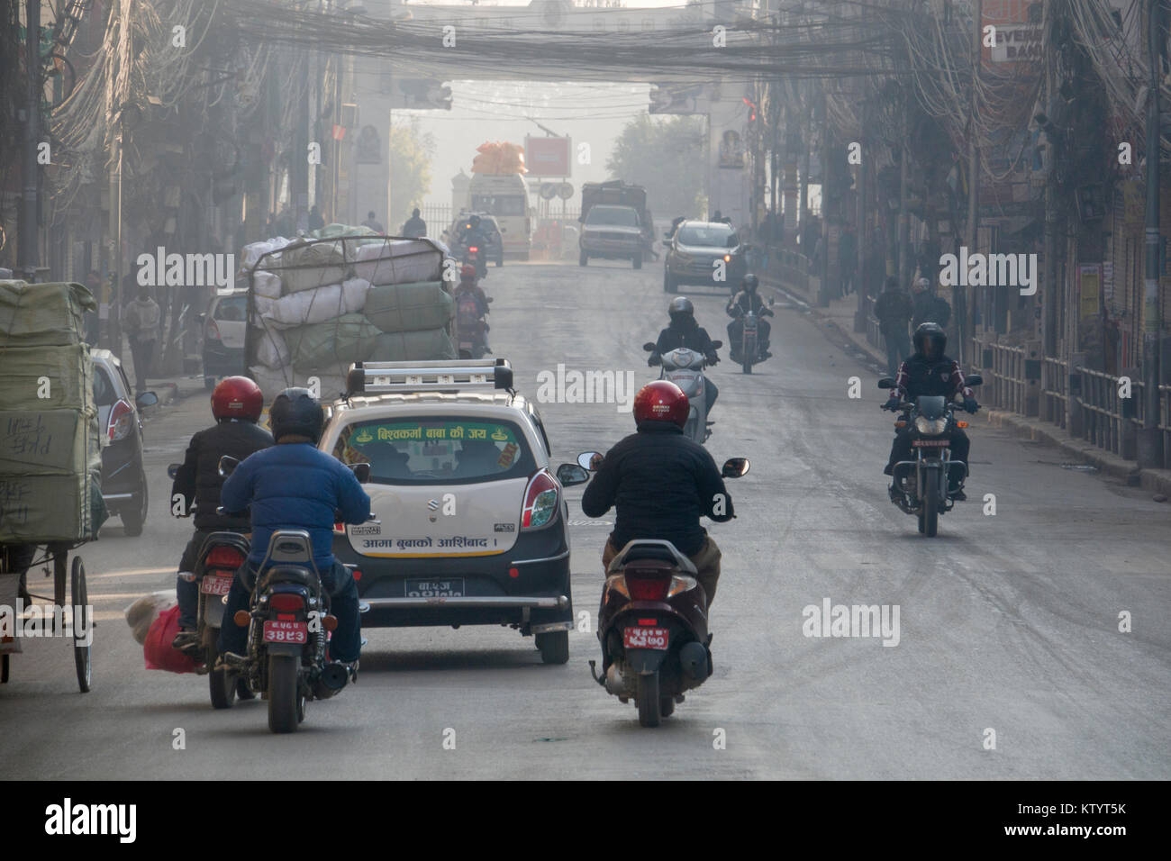 Motorcycles and car traffic in street of Kathmandu, Nepal - Stock Image