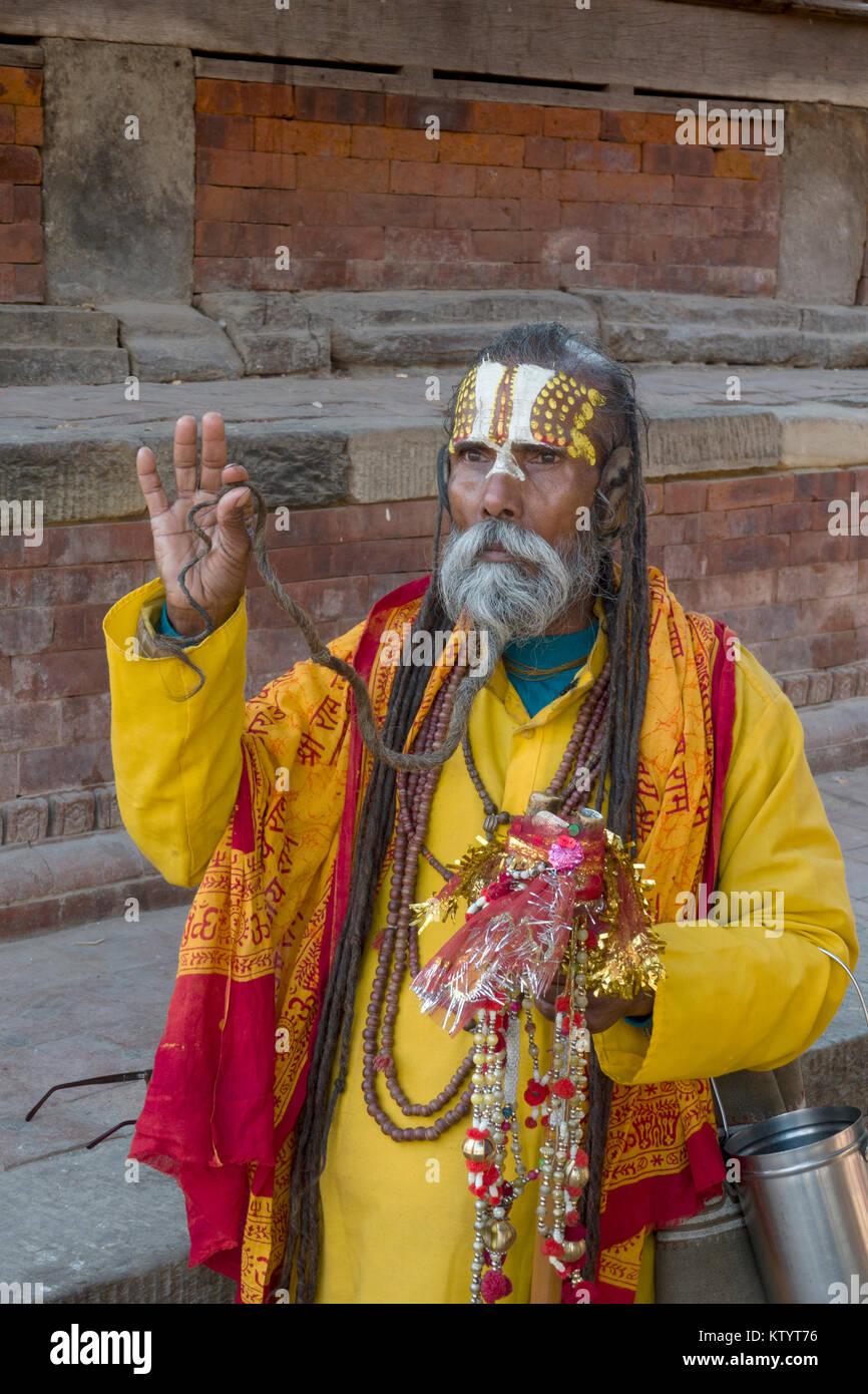 Portrait of Sadhu holy man in Durbar Square, Kathmandu, Nepal - Stock Image