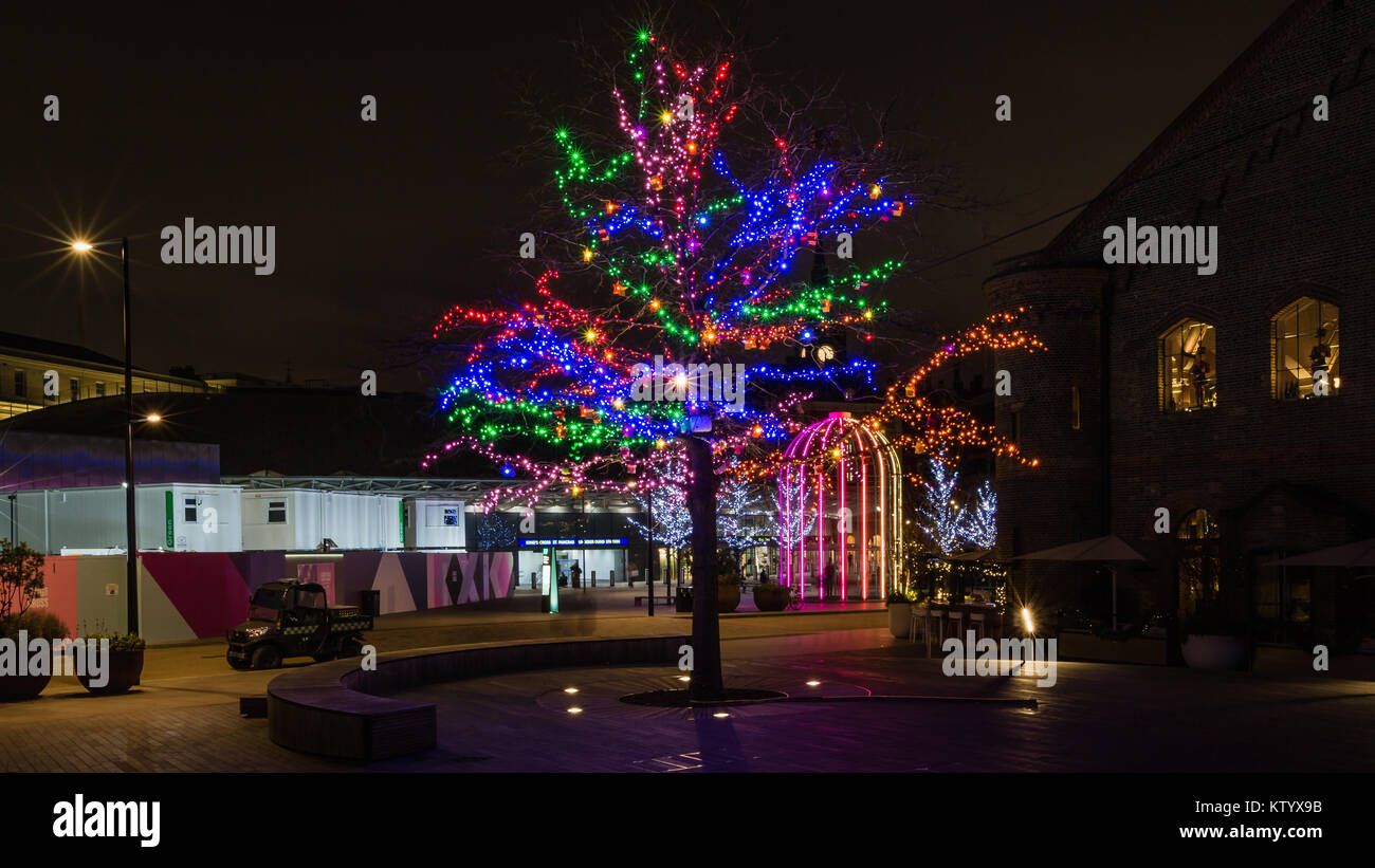 Christmas tree and IFO (identified Flying Object) at Battle Bridge Place in King's Cross, London - Stock Image