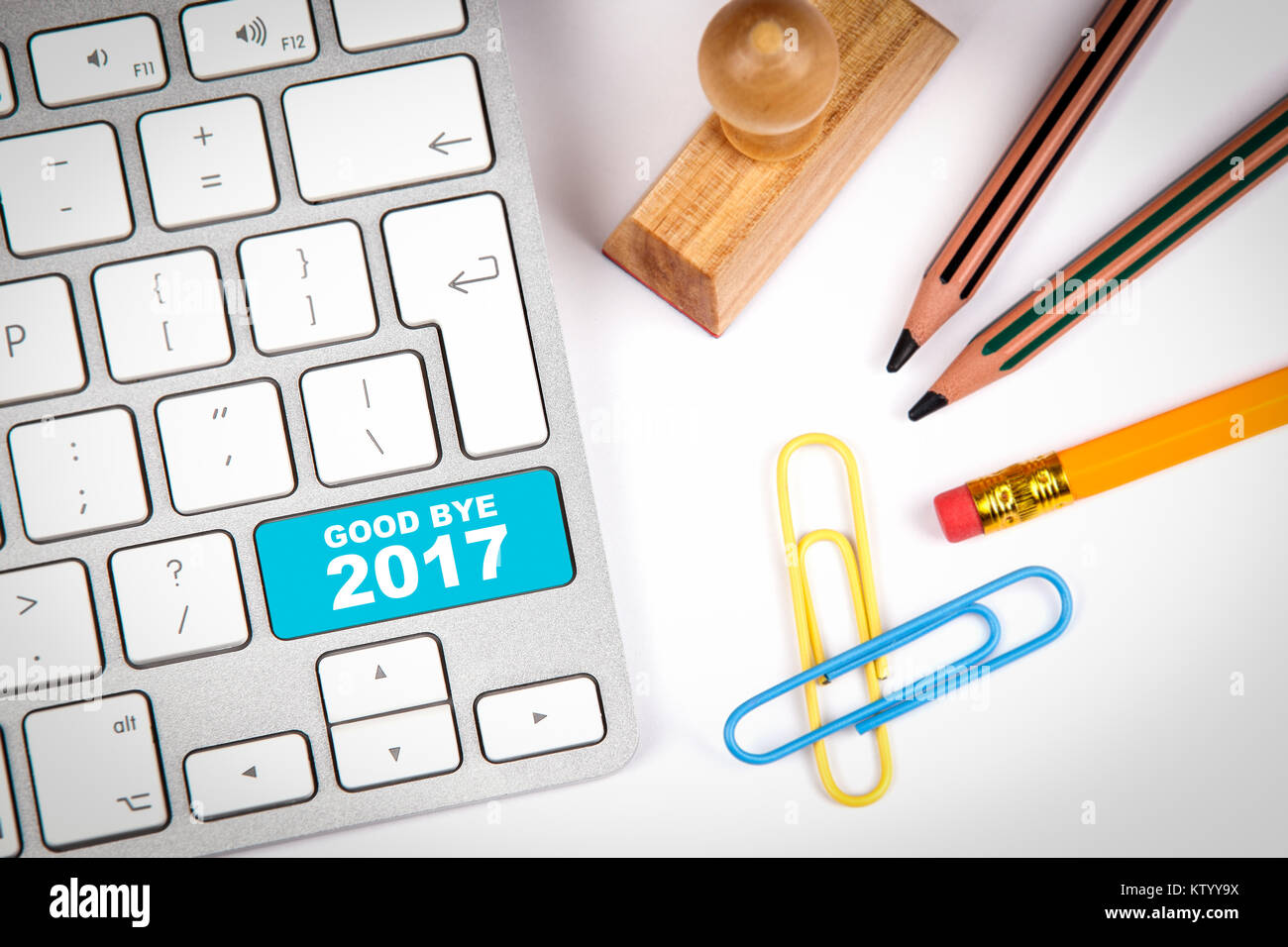good bye 2017, Business concept. Computer keyboard on a white office desk with various items - Stock Image