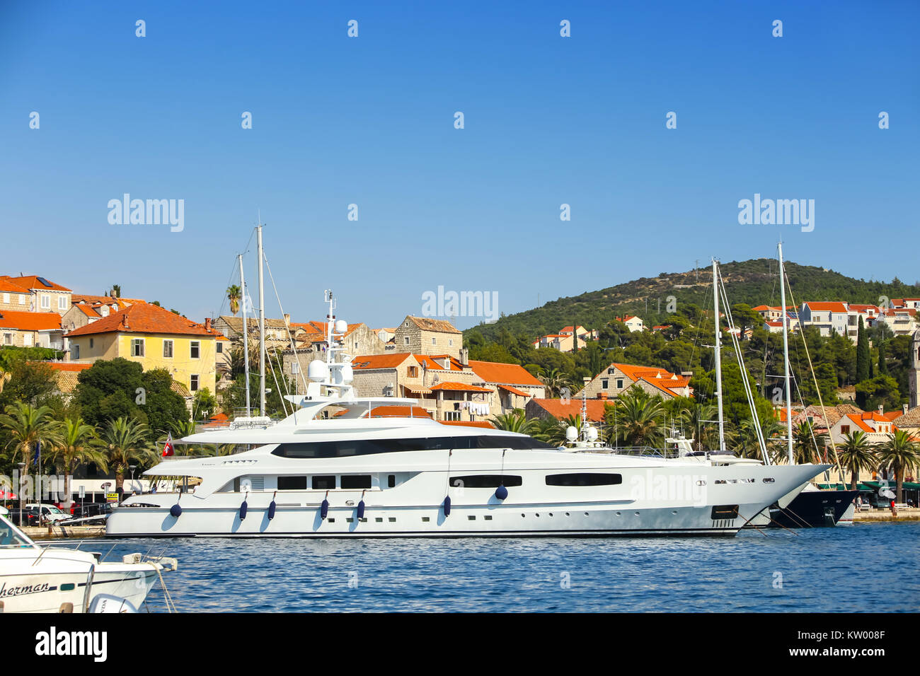 CAVTAT, CROATIA - JULY 20, 2017 : A view of a yacht anchored in front of seaside in Cavtat, Croatia. - Stock Image
