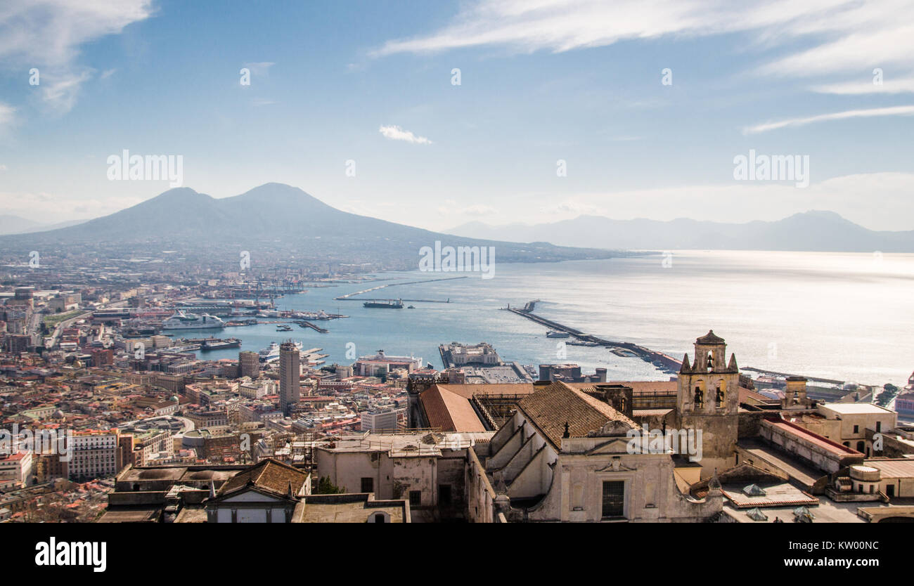 A panoramic shot of Naples with harbour and Vesuvius in the distance. - Stock Image