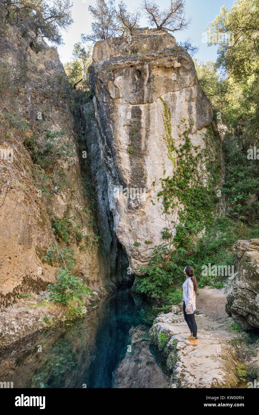 Young woman at Su Gologone karst spring, more than 135 meters deep, near Oliena, Nuoro province, Sardinia, Italy Stock Photo