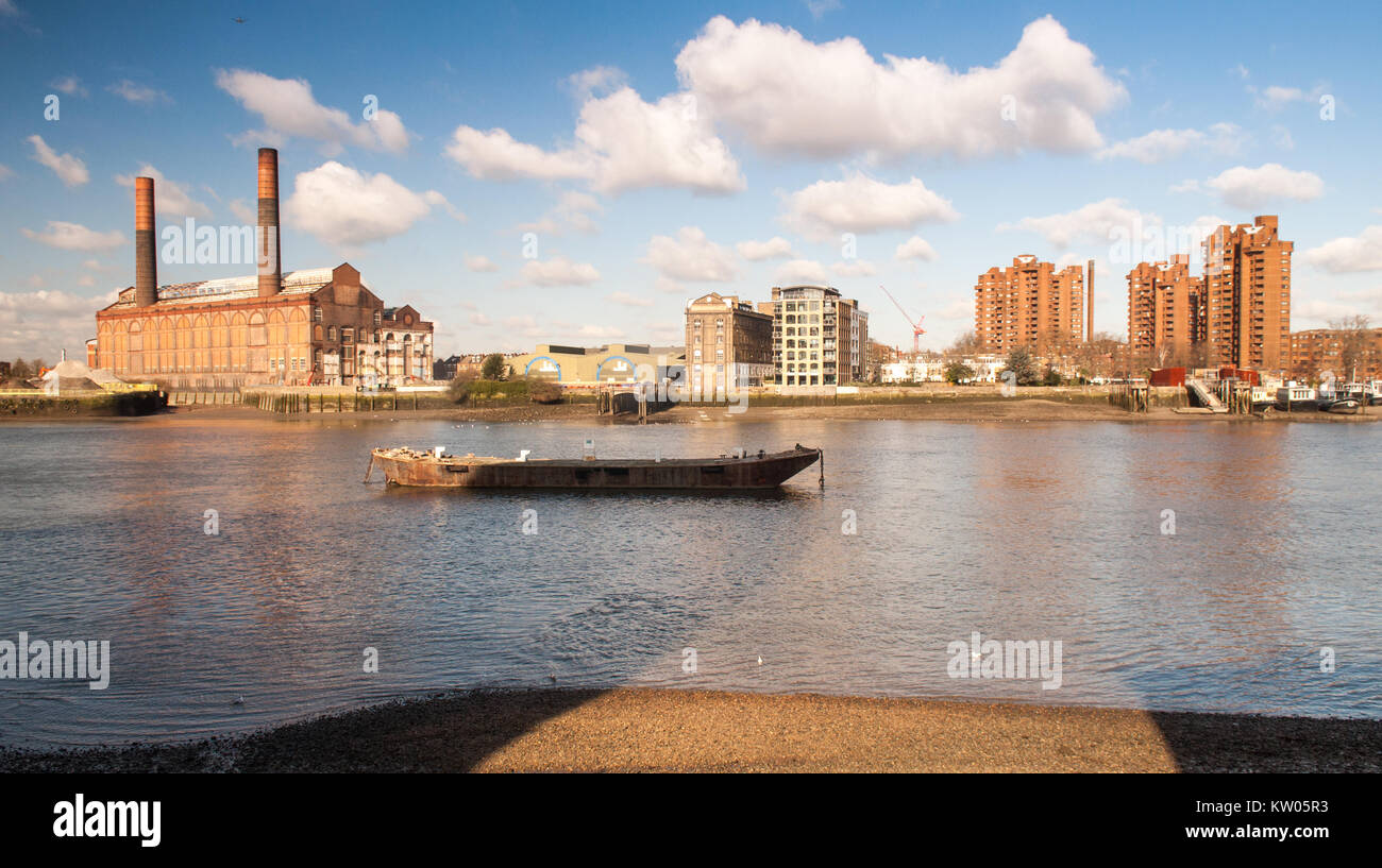 London, England, UK - March 13, 2013: Sunlight illuminates the disused Lots Road Power Station and the World's - Stock Image