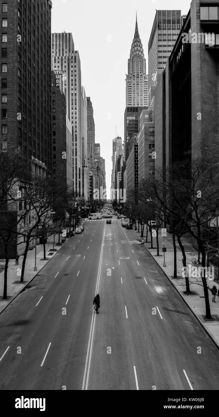 Great view on E 42nd street taken from Tudor City pl, lonely walker catched in the middle of street - Stock Image