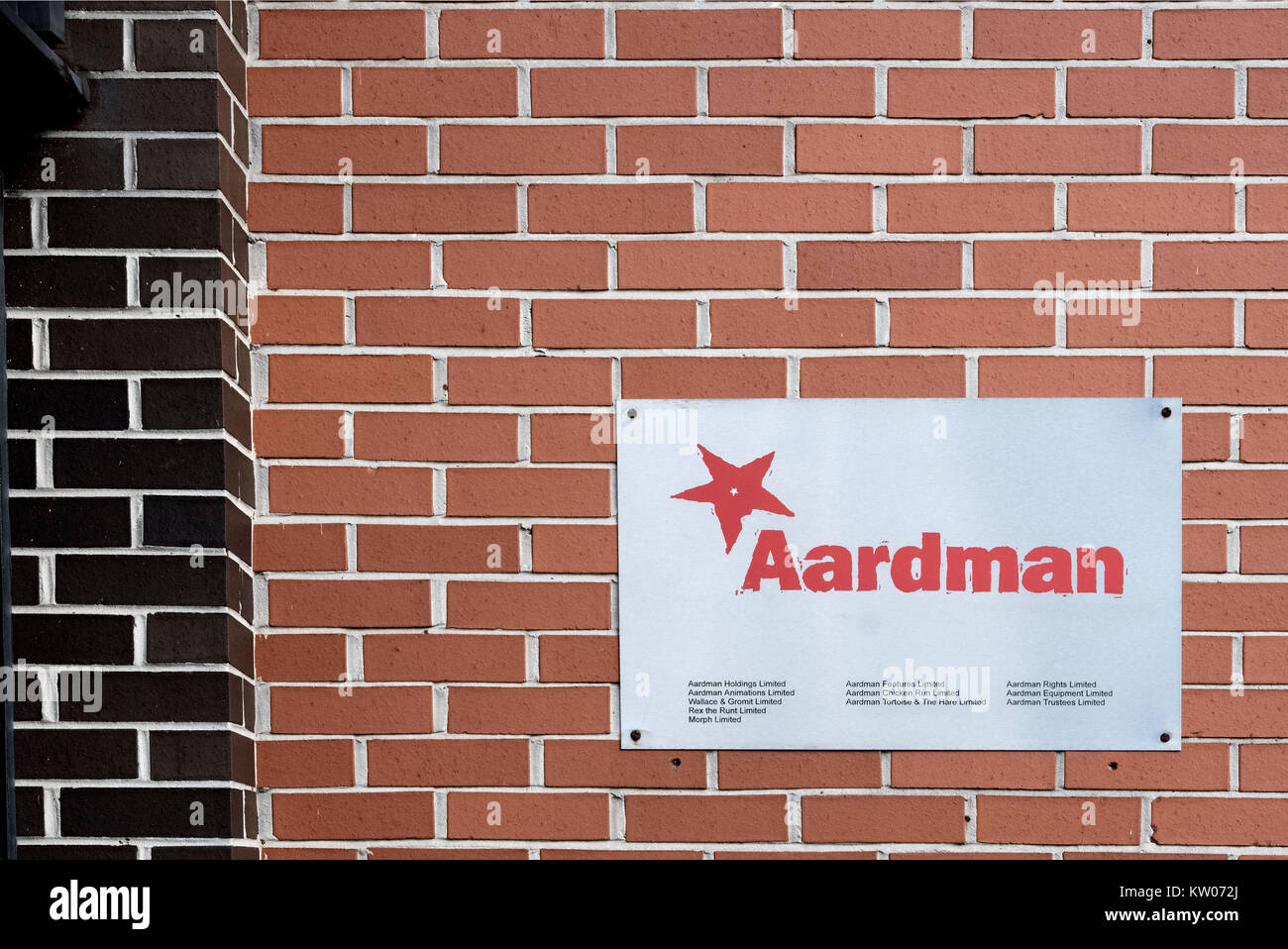 A metal wall plate for Aarman animations on the office wall outside the entrance to their business premises in Bristol, - Stock Image