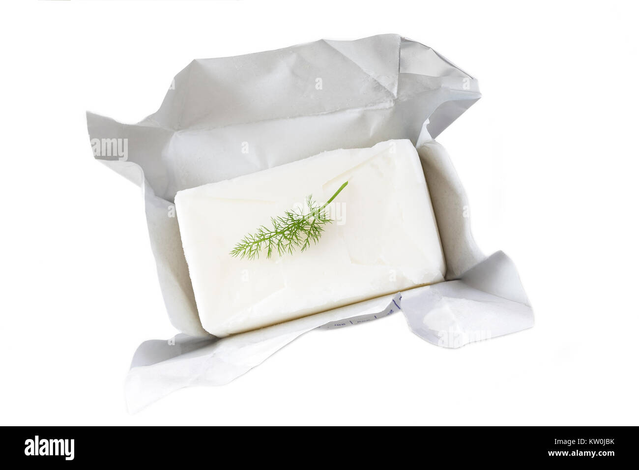 block of pork lard unwrapped , open with parsley on white background - Stock Image