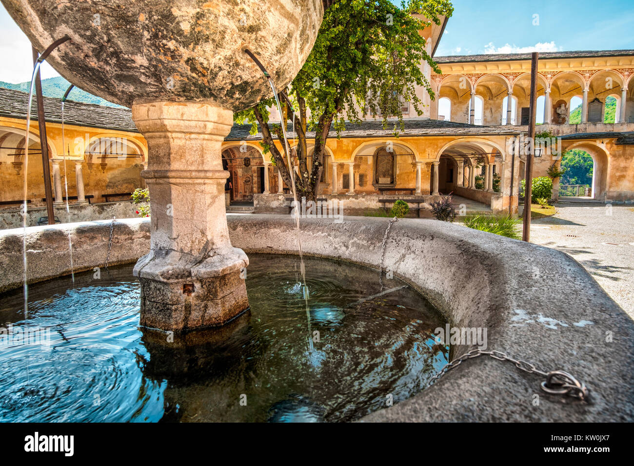 fountain gushing closeup quench thirsty water ancient architectu - Stock Image