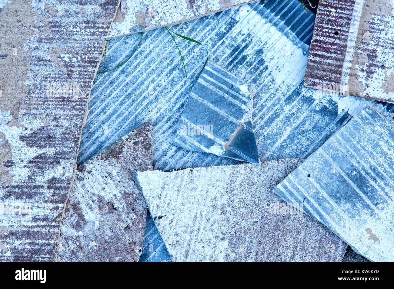 Pile of broken shattered  asbestos shingle siding,  Aransas County, Texas, United States. - Stock Image