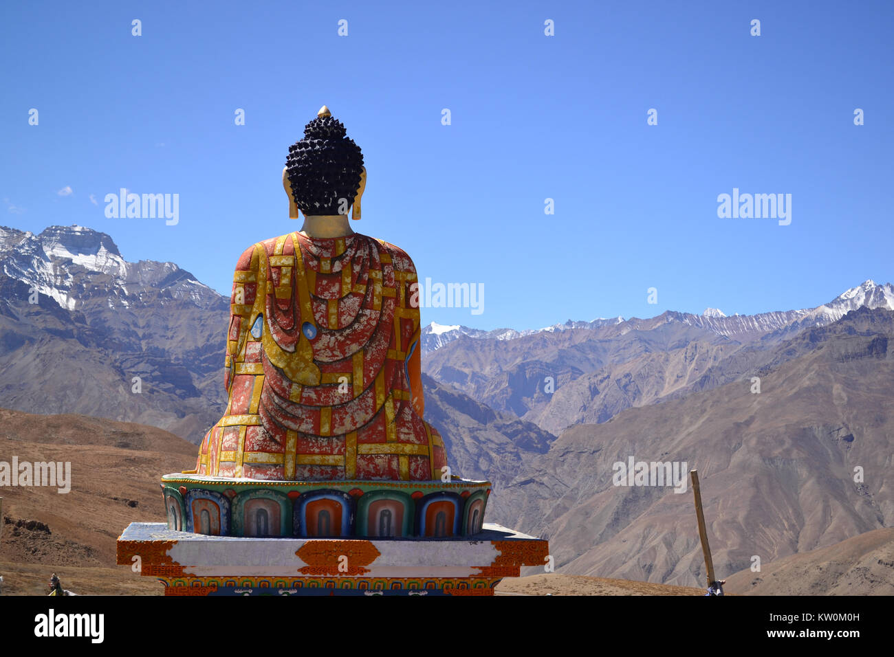 Buddha Statue looking out over the Himalayas, Langza, Himachal Pradesh - Stock Image