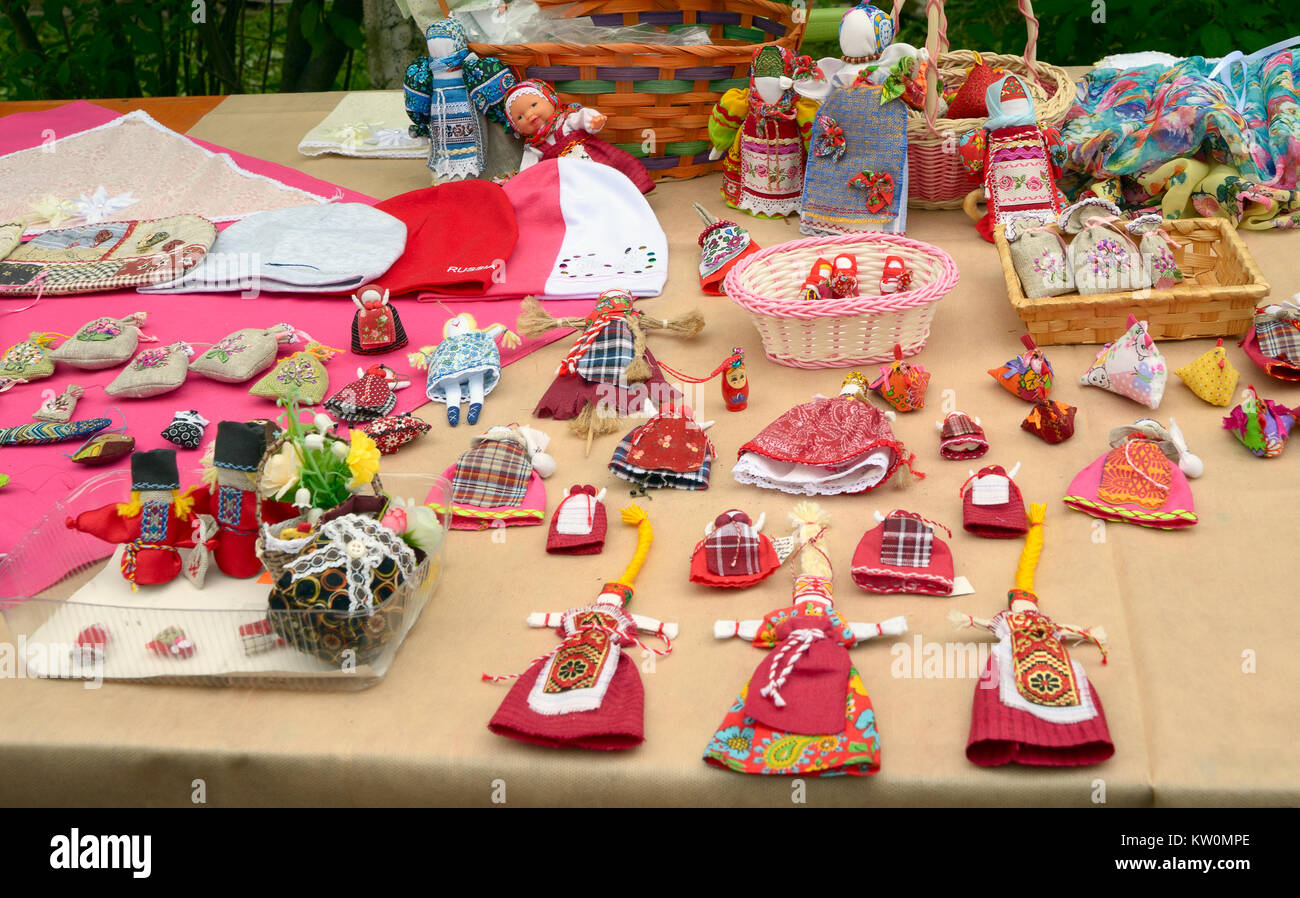St. Petersburg, Russia - May 22, 2016: Vintage handmade toys and dolls in folk style on the counter of the fairs. - Stock Image