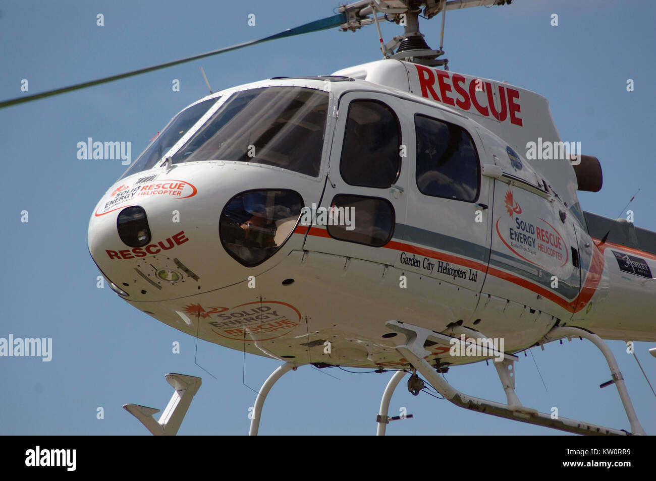 GREYMOUTH, NEW ZEALAND, CIRCA 2007: Pilot of the local Rescue Helicopter prepares to land, circa 2007, near Greymouth, - Stock Image