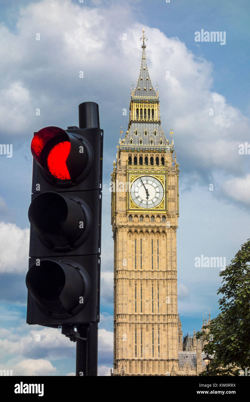 Big Ben, Elizabeth Tower, clock tower with red traffic light in foreground, Westminster, London, UK - Stock Image