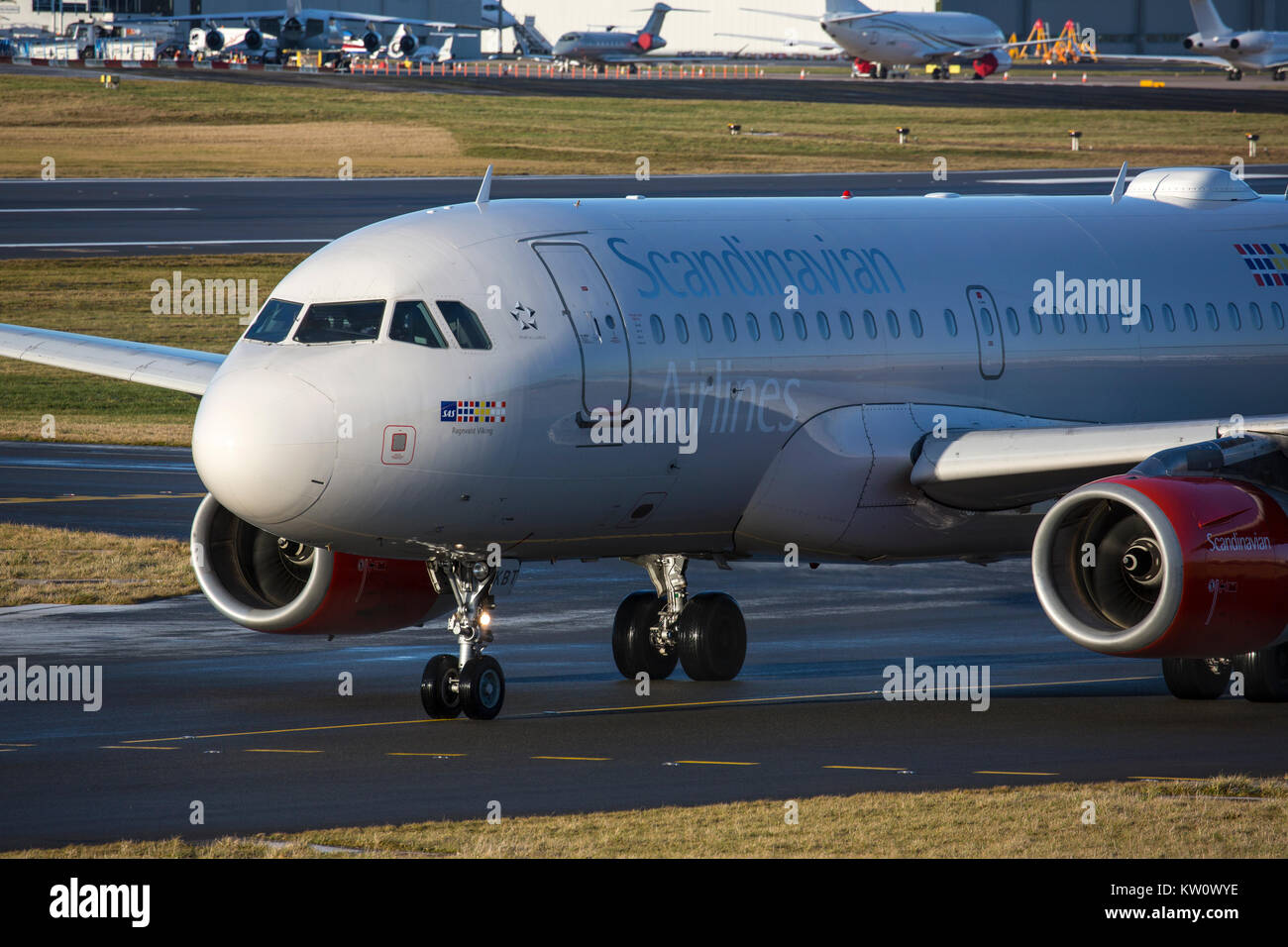 Scandinavian Airline System (SAS) Airbus A319-131 OY-KBT taxying for take off at Birmingham International Airport - Stock Image