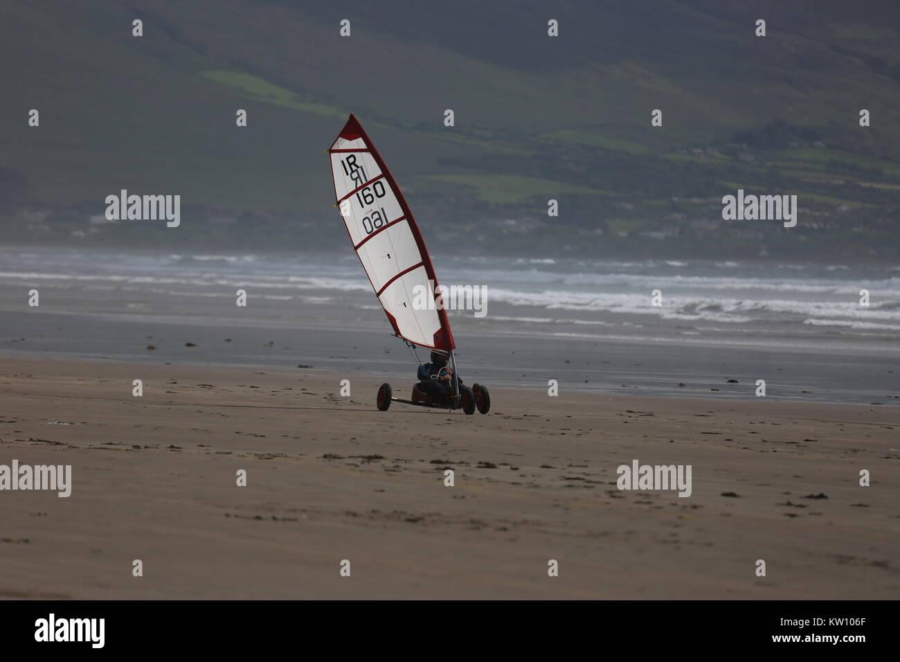 Beach surfing on a beach in Ireland - Stock Image