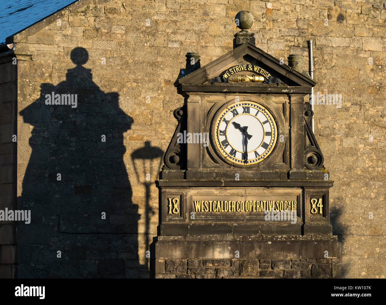The West Calder Co-operative clock in West Calder, West Lothian - Stock Image
