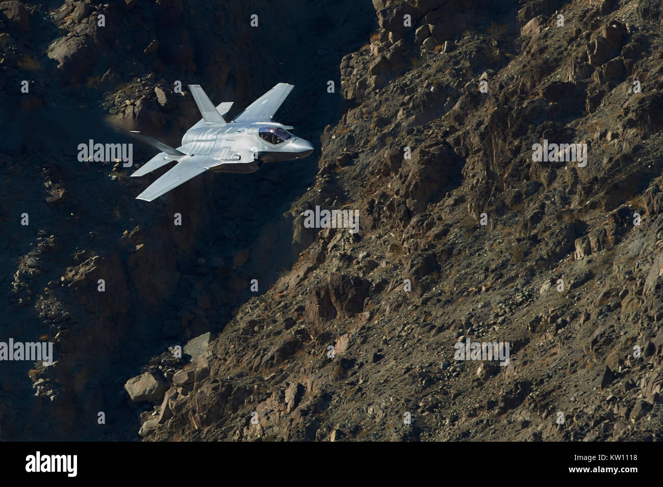 A Futuristic Lockheed Martin F-35A Lightning II Joint Strike Fighter (Stealth Fighter), Flying At Low Level Through - Stock Image