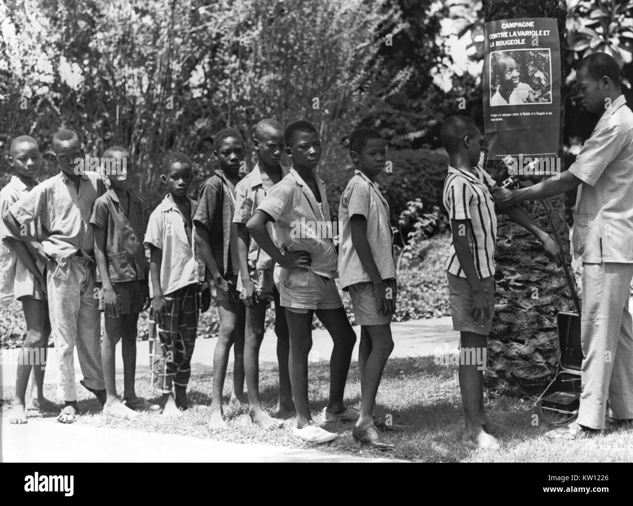 The Smallpox Eradication and Measles Control Programs, West Africa, 1968. Vaccination of boys in West Africa while - Stock Image