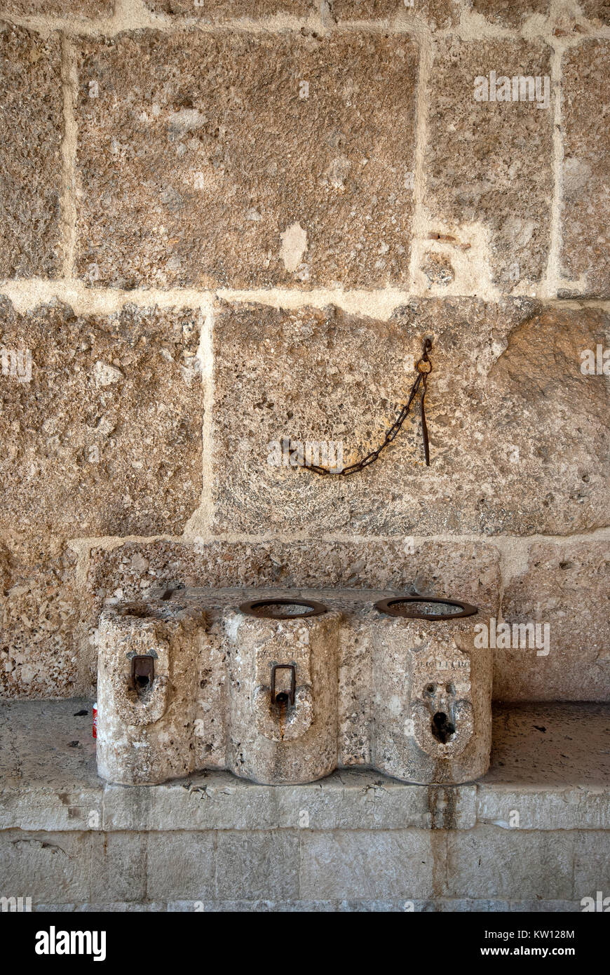 Stone containers known as 'measures' in the old covered market of cereals, known as Porch of Measures, Norcia - Stock Image