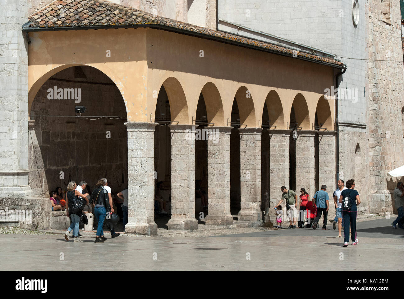 Ancient covered market of cereals, known as Porch of Measures, next to San Benedetto Church in Norcia (before earthquake - Stock Image