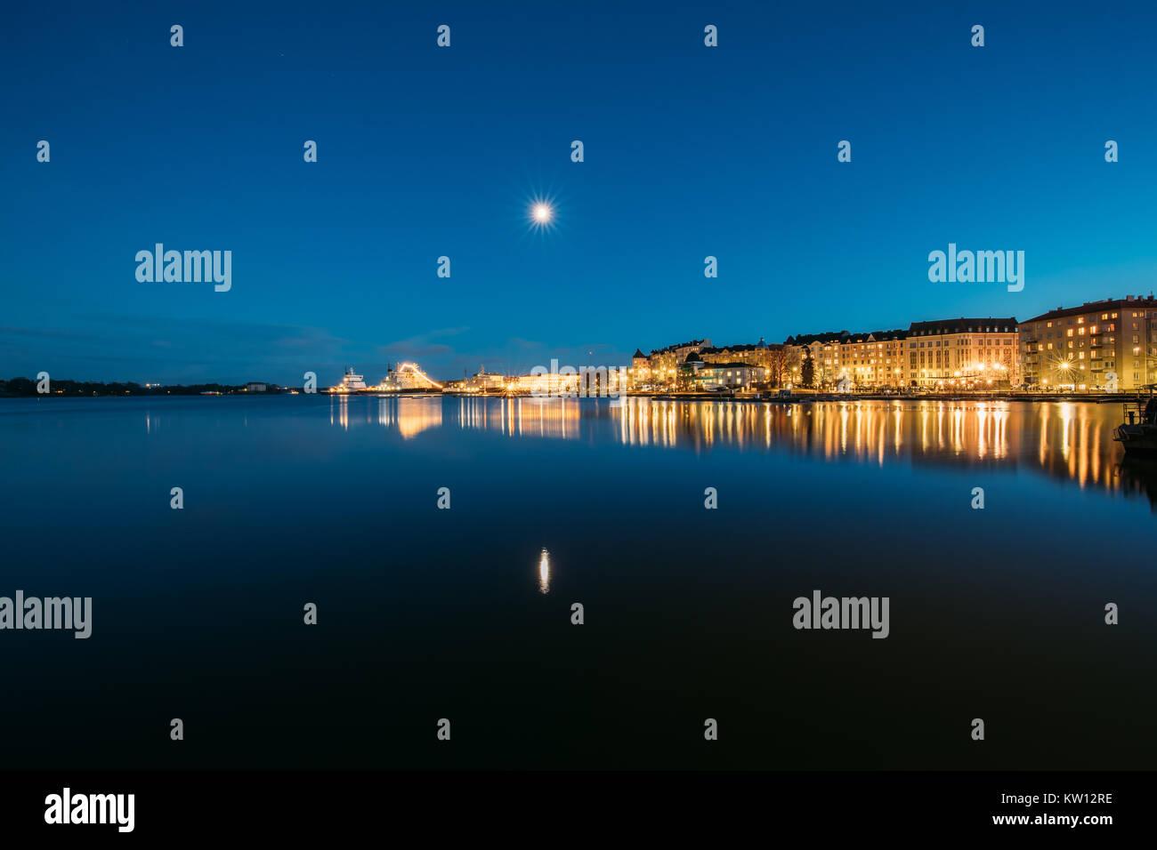 Helsinki, Finland. View Of Police Harbor Merikasarmin Laituri And Laivastokatu Street In Evening Night Illuminations. - Stock Image
