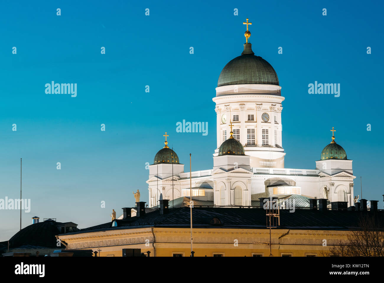 Helsinki, Finland. Famous Landmark Is Lutheran Cathedral In Night Evening Lighting. Stock Photo
