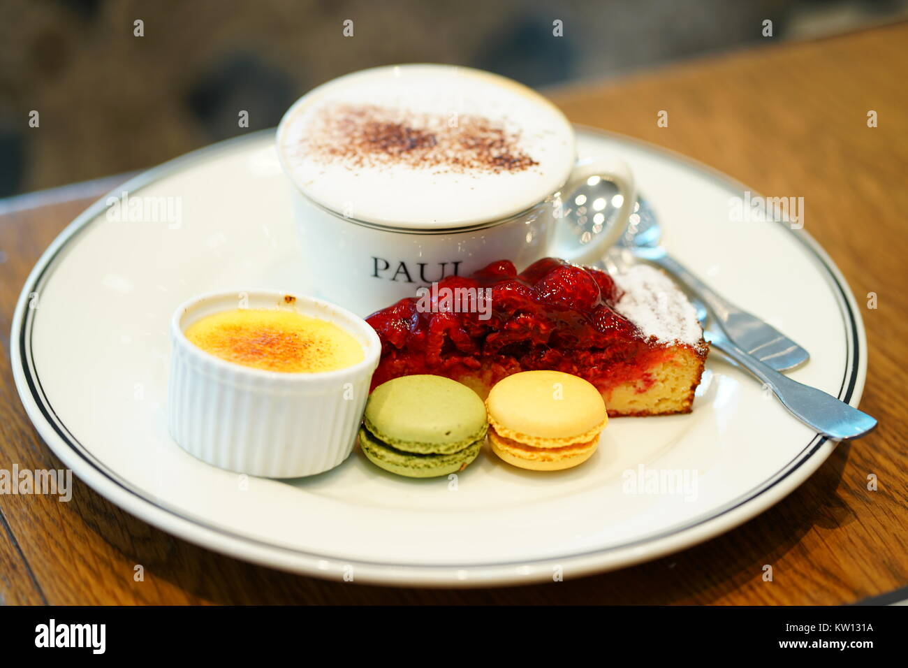 Brunch time with Brulee, Cappucino, Cheese Cake, Macarons - Stock Image