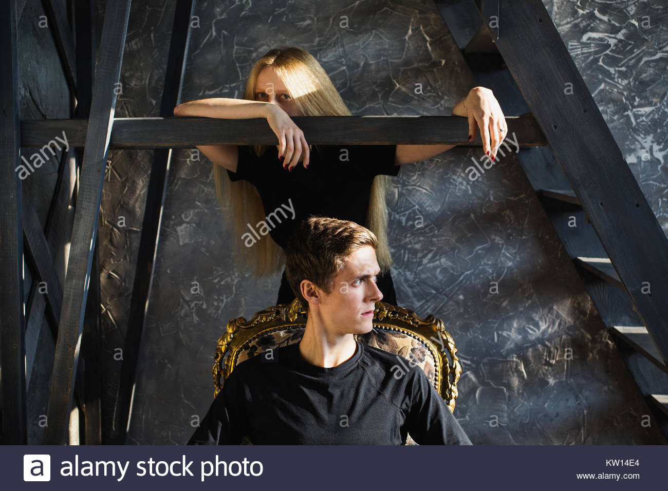 A young man and young blonde woman with long hair. Problems and difficulties in relations. Difficult situation in - Stock Image
