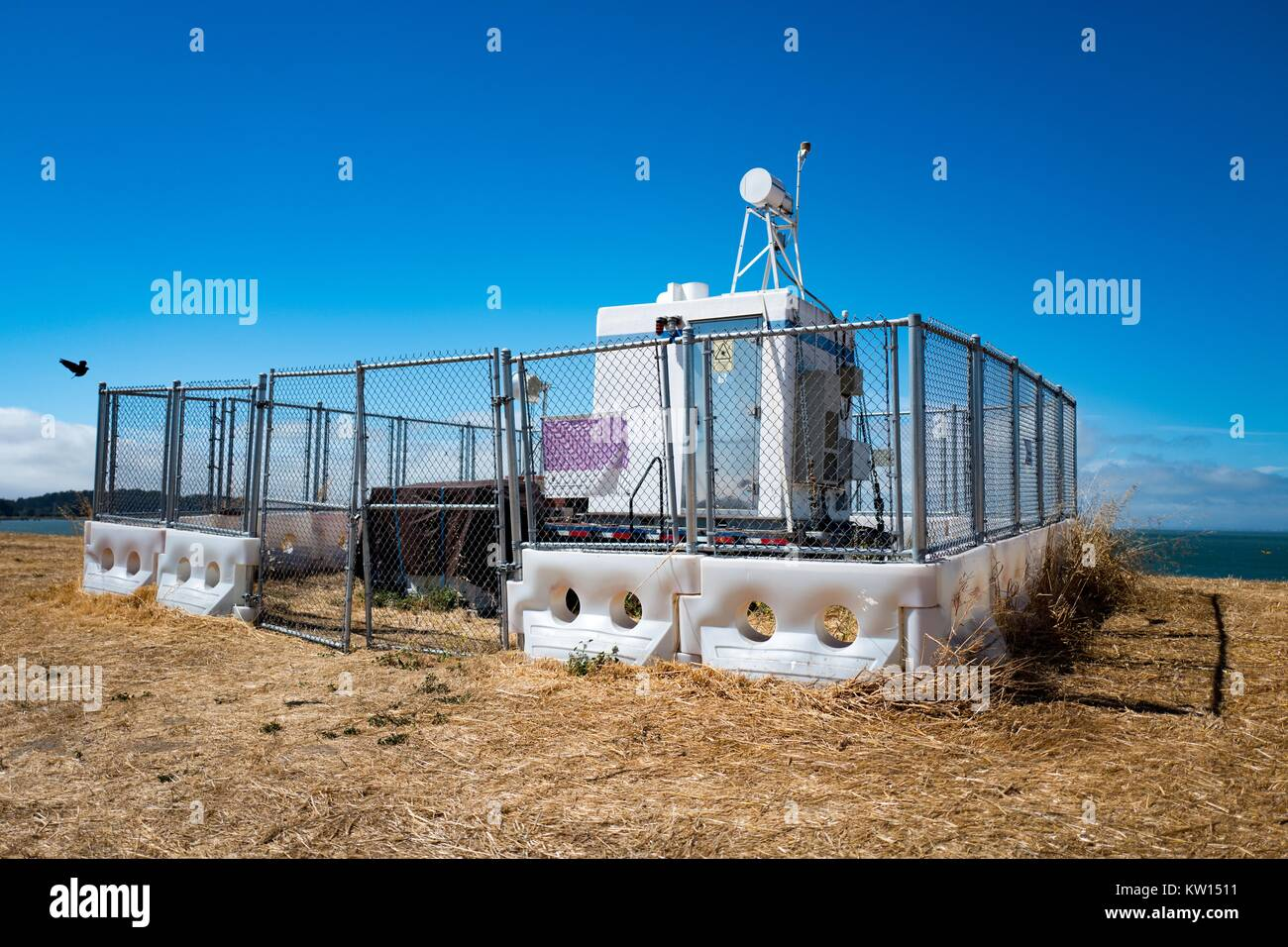 Beacon station for the Instrument Landing System of San Francisco International Airport, on a hill in Seal Point - Stock Image