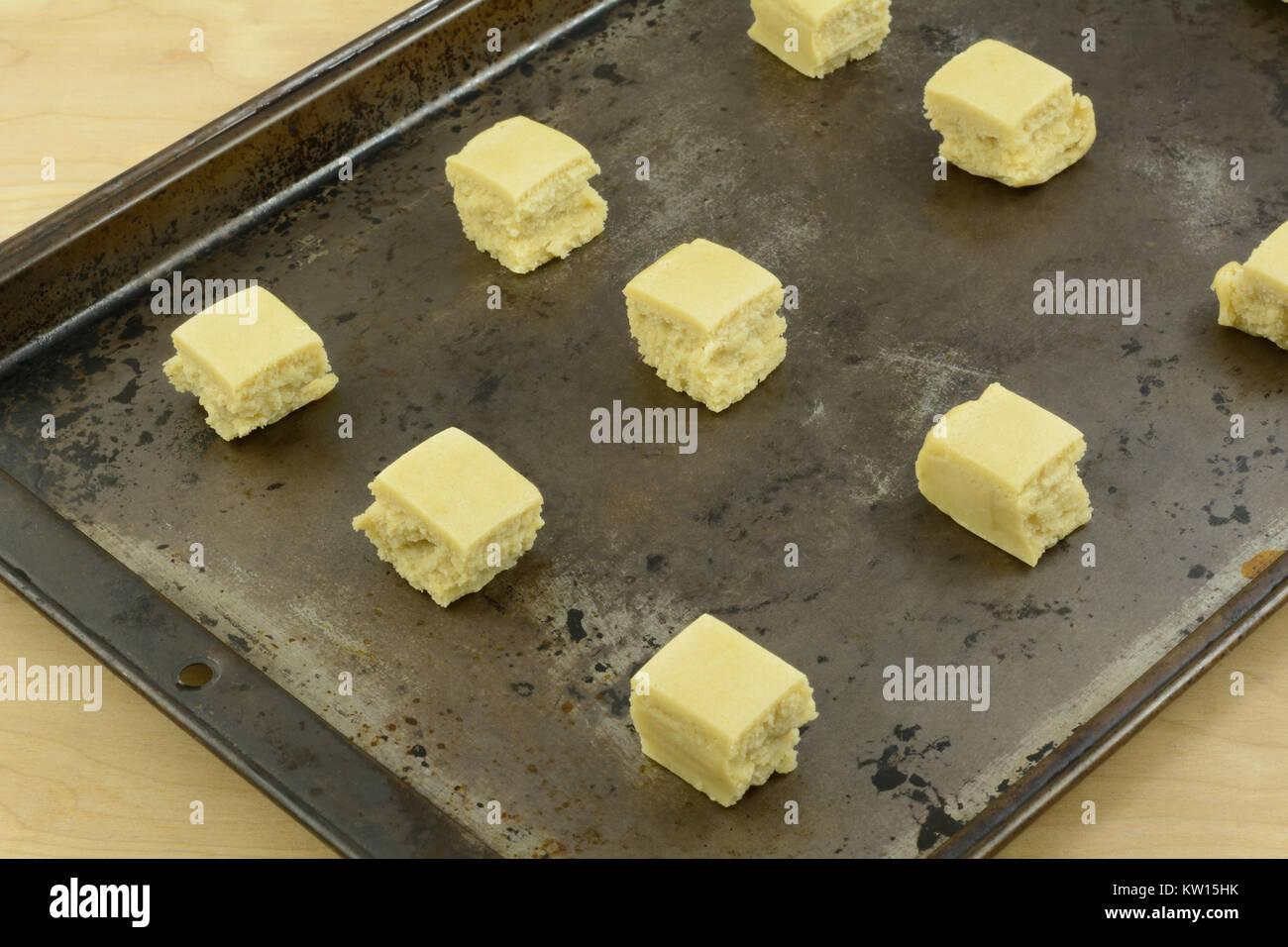 Pre Cut Sugar Cookie Dough Cubes Arranged On Baking Pan In Stock
