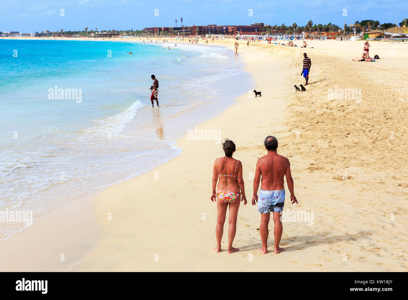 Tourists on the public beach at Santa Maria, Sal, Cape Verde, Africa - Stock Image
